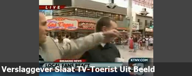Verslaggever Slaat TV-Toerist Uit Beeld