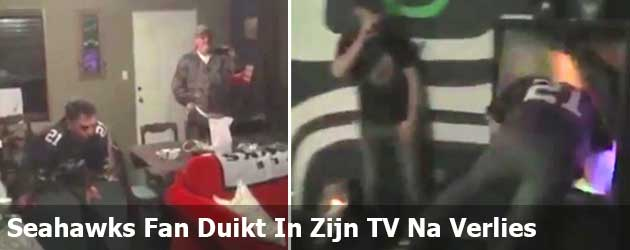 Seahawks Fan Duikt In Zijn TV Na Verlies