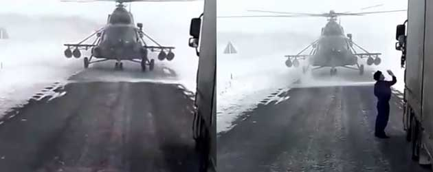 Helikopterpiloot komt even de weg vragen aan een vrachtwagenchauffeur