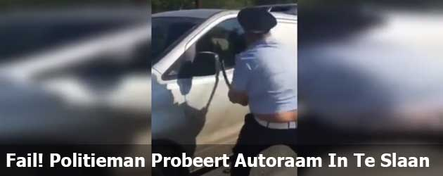 Fail! Politieman Probeert Autoraam In Te Slaan
